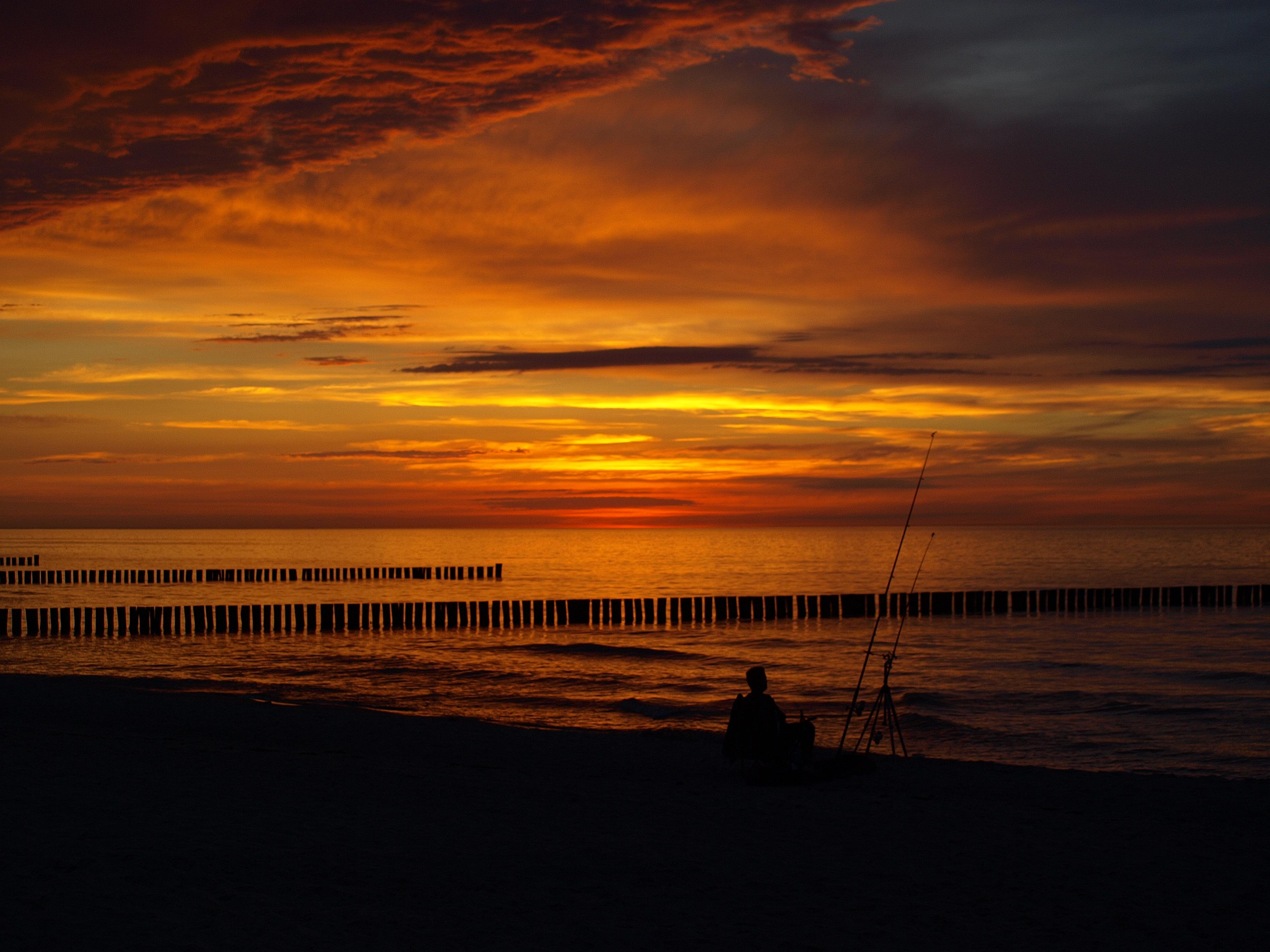 Sonnenuntergang mit Angler